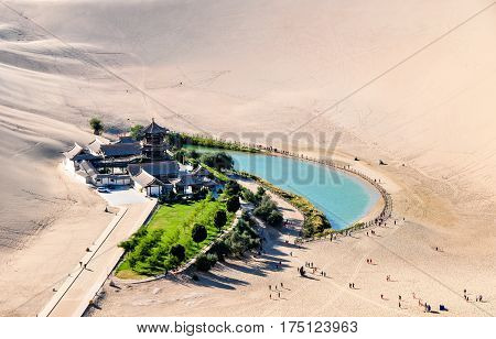 Chinese Asian Crescent Spring dune God Mingsha mountain desert springs first spring tourism in Gansu scenic spots of Dunhuang sand.