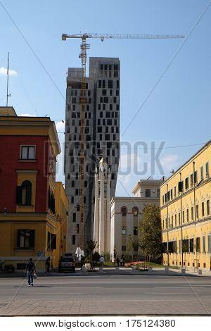 TIRANA, ALBANIA - SEPTEMBER 27: Orthodox Cathedral is overshadowed by new high-rise construction, Tirana, Albania on September 27, 2016.
