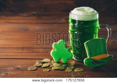 Beautiful Background For St. Patrick's Day With A Glass Of Green Beer, Gold Coins And Hat On Wooden