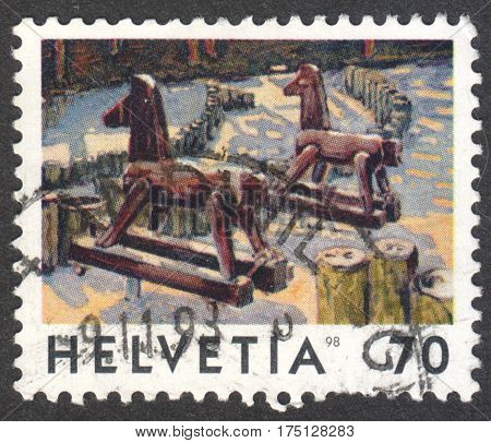 MOSCOW RUSSIA - CIRCA FEBRUARY 2017: a post stamp printed in SWITZERLAND shows the Deux Chevaux by Jean-Frederic Schnyder the series
