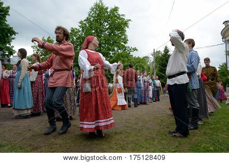 St. Petersburg Russia - May 22 2016: People in the Russian national suits are dancing at an annual Nikolsky festival of folk art in St. Petersburg.