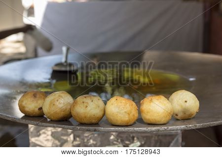 aloo tikki on pan in india restaurant at Dilli Haat Delhi India. Dilli Haat is traditional marketplace in delhi