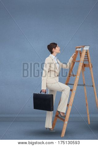 Businesswoman with briefcase climbing on step ladder against blue background