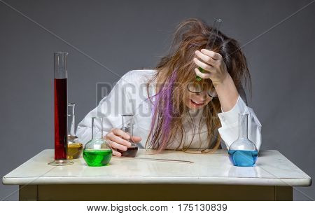 Problem and scientist with glass flask on gray background