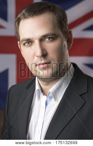 Portrait of a business man on the background of the British flag