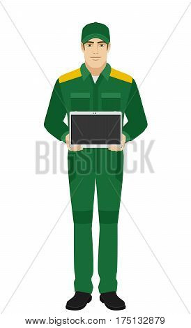 Man in uniform showing blank digital tablet PC. Man in uniform Full length portrait of Delivery man or Worker in a flat style. Vector illustration.