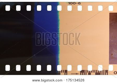 Strip of the poorly exposed and developed celluloid film on white background
