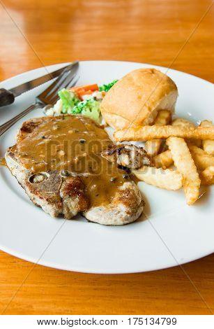 Pork chop steak / cooking pork chop steak concept