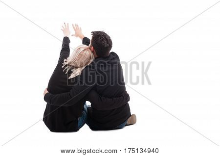 Rear View Of Young Couple Sitting Down