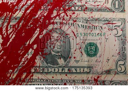 Closeup of Dollar Banknote with Red Color Splash like Blood