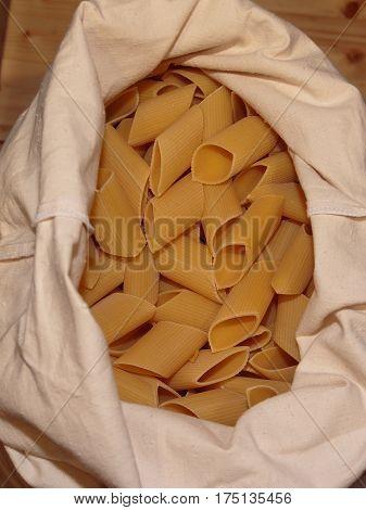 Mezze Penne, Raw Italian Pasta In White Sack