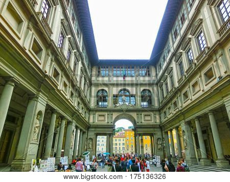 Florence, Italy - May 01, 2014: People in front of Uffizi Gallery. It is among the oldest and most famous art museums of Europe. The building was begun by Giorgio Vasari in 1560.