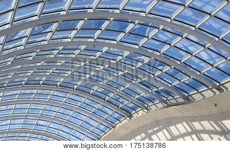 Interior of modern shopping mall with glass ceiling