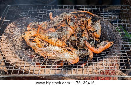 Grilled shrimp or easy BBQ grilled shrimp on electric grill. Closeup - Frozen shrimp fresh shrimp sausage or bacon strips use indoor electric grill if the weather is not good for outside grilling.