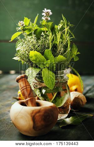 Herbs and spices with Mortar and Pestle on wooden background