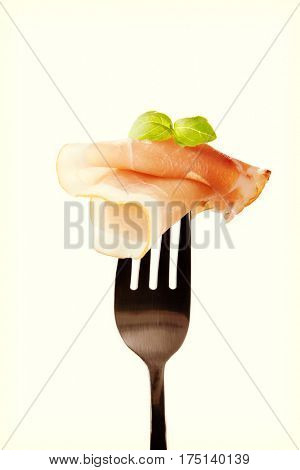 Black forest ham on fork