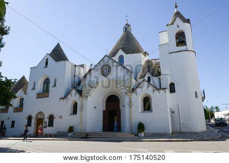 Beautiful Town Of Alberobello With Trulli Church