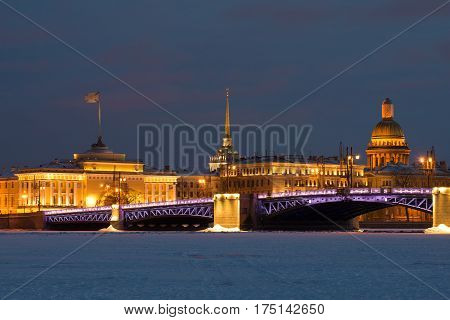 Palace bridge Admiralty and St. Isaac's Cathedral evening in February. View from the frozen Neva river. Winter Saint-Petersburg