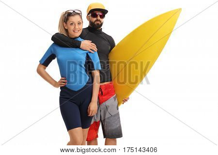 Female surfer with a male surfer holding a surfboard isolated on white background