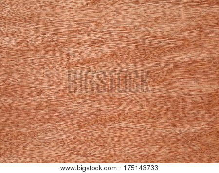 Orange color wood grain texture surface detail.