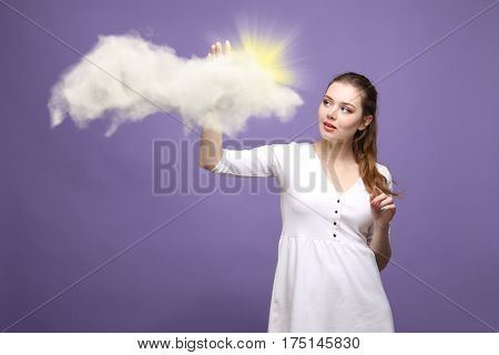 Woman with cloud and sun. Concept on the topic of computer cloud services.