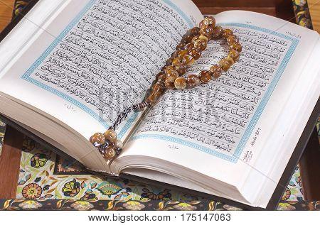 Prayer Beads On The Koran.