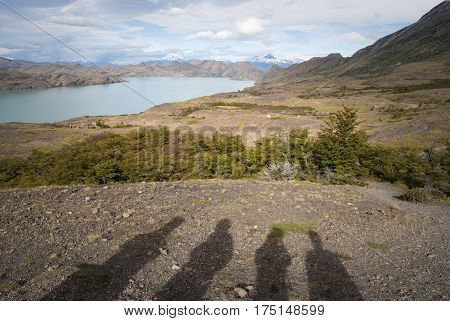 Four shadow silhouettes enjoying a inspiring and beautiful landscape