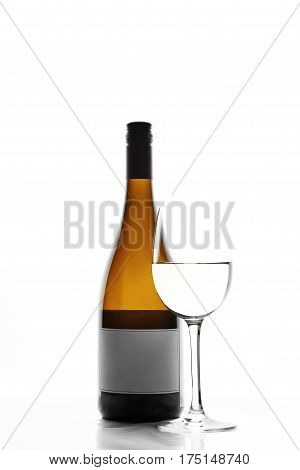 Glass and bottle of white wine. Bottles of white wine