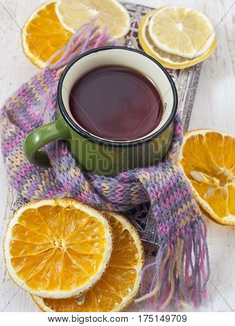 Up Of Hot Tea With And Scarf.