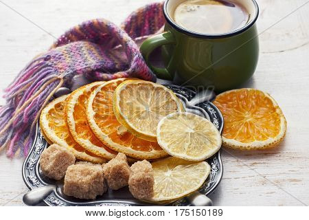 Orange And Lemon Slices On Old Wooden Table. Winter Time.