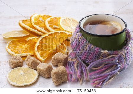 Up Of Hot Tea With Lemon And Scarf. Lemon And Orange Slices,