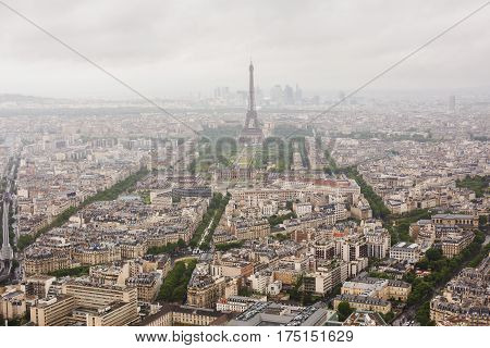 View of the streets of Paris from the heights. Travel through Europe. Attractions in France. Cloudy Paris in France. Clouds in the sky. Eiffel Tower in France