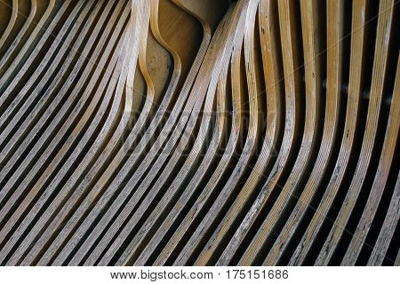 Close up view on wooden striped shabby bench