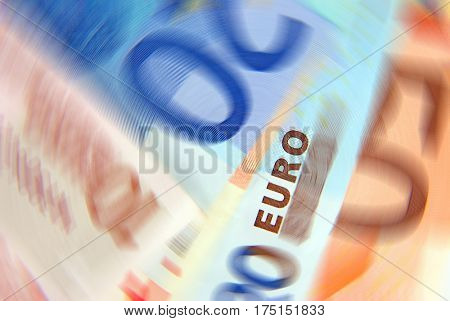 Conceptual image showing Euro banknotes with a spin effect.