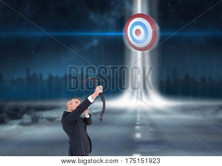 Businessman holding a cross bow and aiming at the target board cityscape in background
