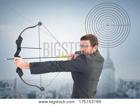 Businessman holding bow and arrow while aiming against cityscape in background