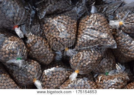 Pellet food in the plastic bags popular for fish in parks or in temples.