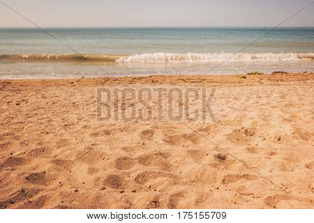Shore of sea. Yellow sand and water. Good place for summer rest. Paradise far from civilization.