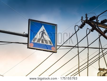 Crosswalk traffic sign and electrical transmission lines