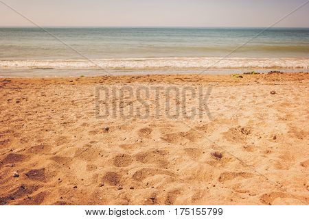Horizon and sea. Water and yellow sand. Nice place for summer rest. Paradise far away from civilization.