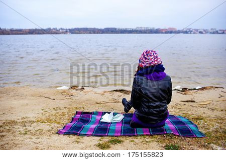 A Woman On The Beach Starring At The Restless Sea