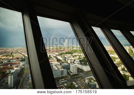 Double rainbow in sky. Travel to Germany. View of the houses and streets of Berlin with a bird's-eye view. Overcast sky. Double Rainbow in Berlin