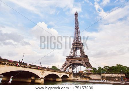 Walk on the ship on the river Seine in Paris. Travel through Europe. Eiffel Tower against the sky in Paris. Attractions in France. Eiffel Tower in summer