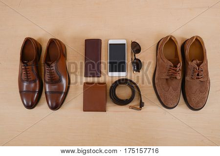 Men's casual outfits with man c accessories on wooden background,