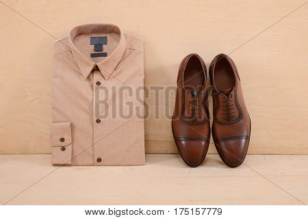 Men's clothing,shoes on wooden background,