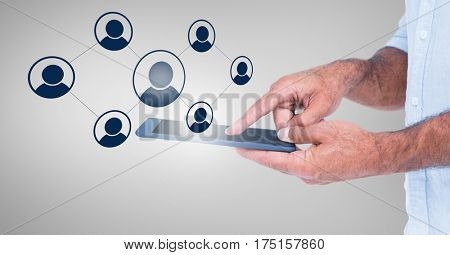 Mid section of man using smart phone with digitally generated application icons against grey background