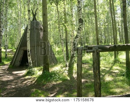 The Tofalar settlement in the pine forest. Tofalar - semi-nomadic people, whose main occupation is hunting and reindeer herding. Lake Baikal, Russia