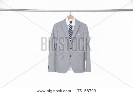 men's suits ,shirt with ties on hanging