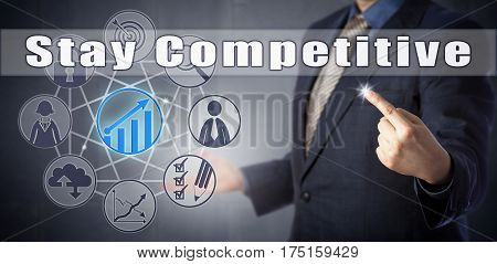 Male business coach in blue suit is demanding to Stay Competitive. Business concept for performance management metaphor for adaptation in a commercial marketplace and motivational call to action.