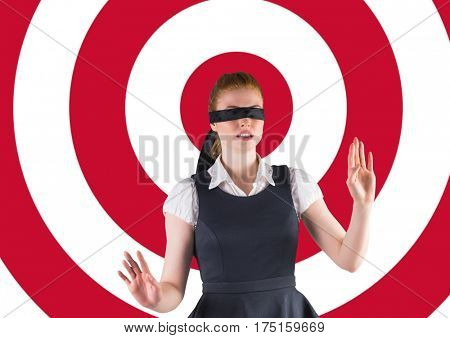 Blindfolded woman walking with her hands forward against red white target background